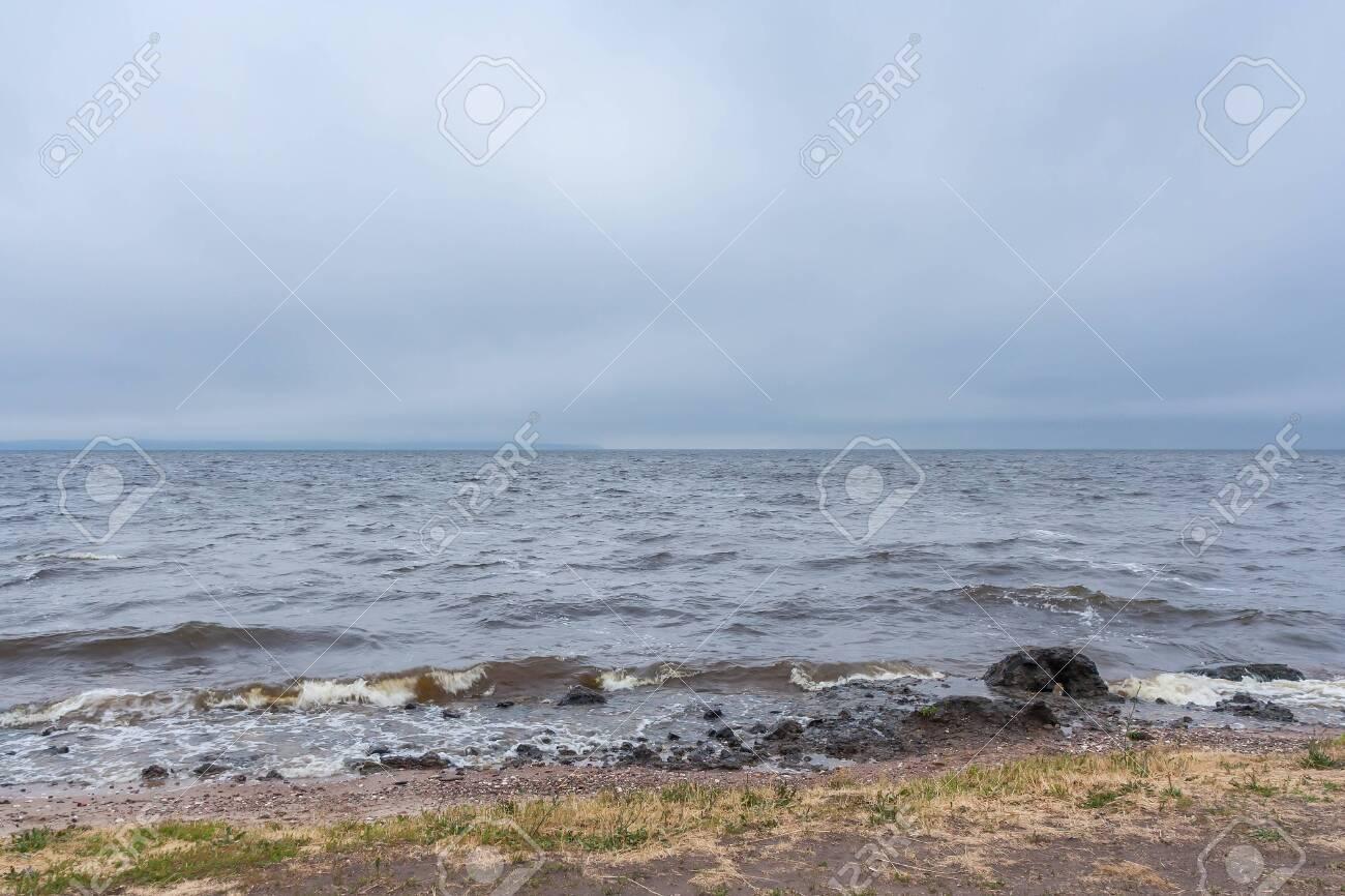 Storm at sea, river reservoir at summer - 144847222