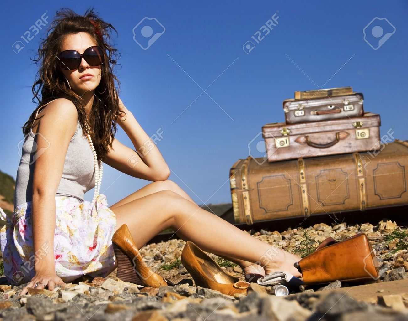 Young traveling woman with her suitcases along the road Stock Photo - 9670128