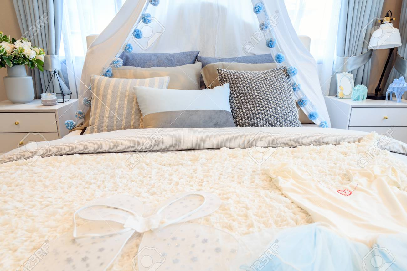 Groovy A Beautiful Light Blue Bedroom Girl With A Patterned Pillows Beutiful Home Inspiration Xortanetmahrainfo