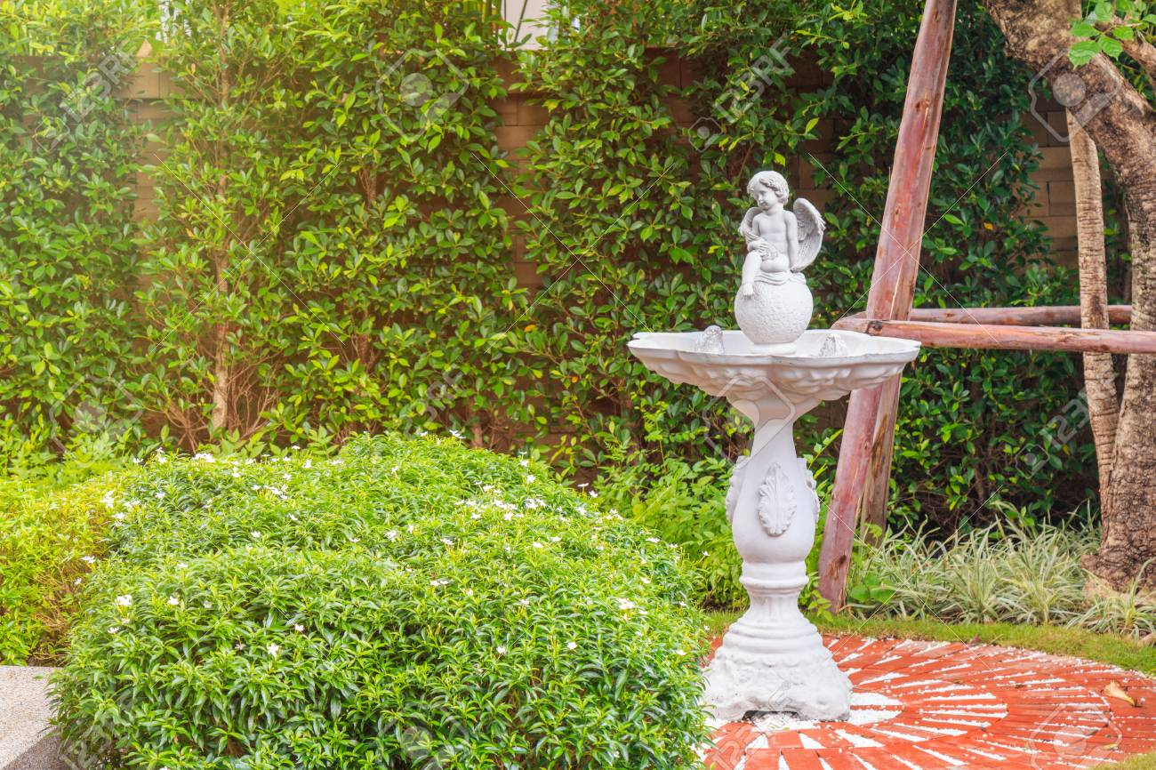 A Baby Angle Statue On Red Stone Path In The Garden With Nature Stock Photo Picture And Royalty Free Image Image 100768796