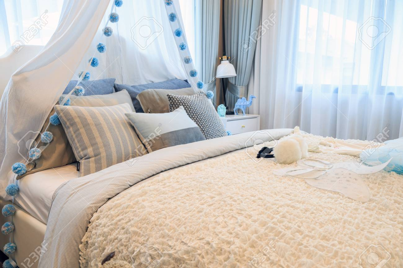 Pleasing A Beautiful Light Blue Bedroom Girl With A Patterned Pillows Beutiful Home Inspiration Xortanetmahrainfo