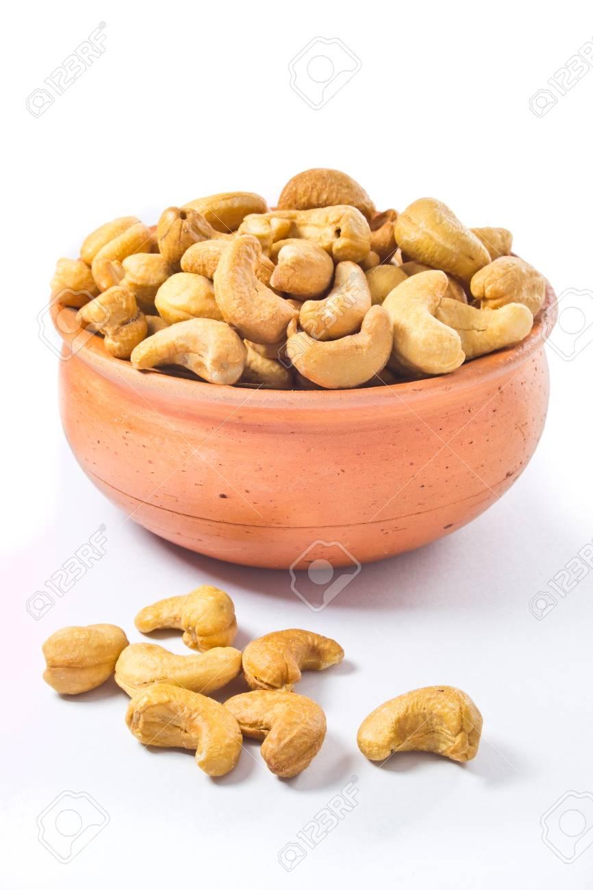 cashews nut in bowl on white background Stock Photo - 17860770