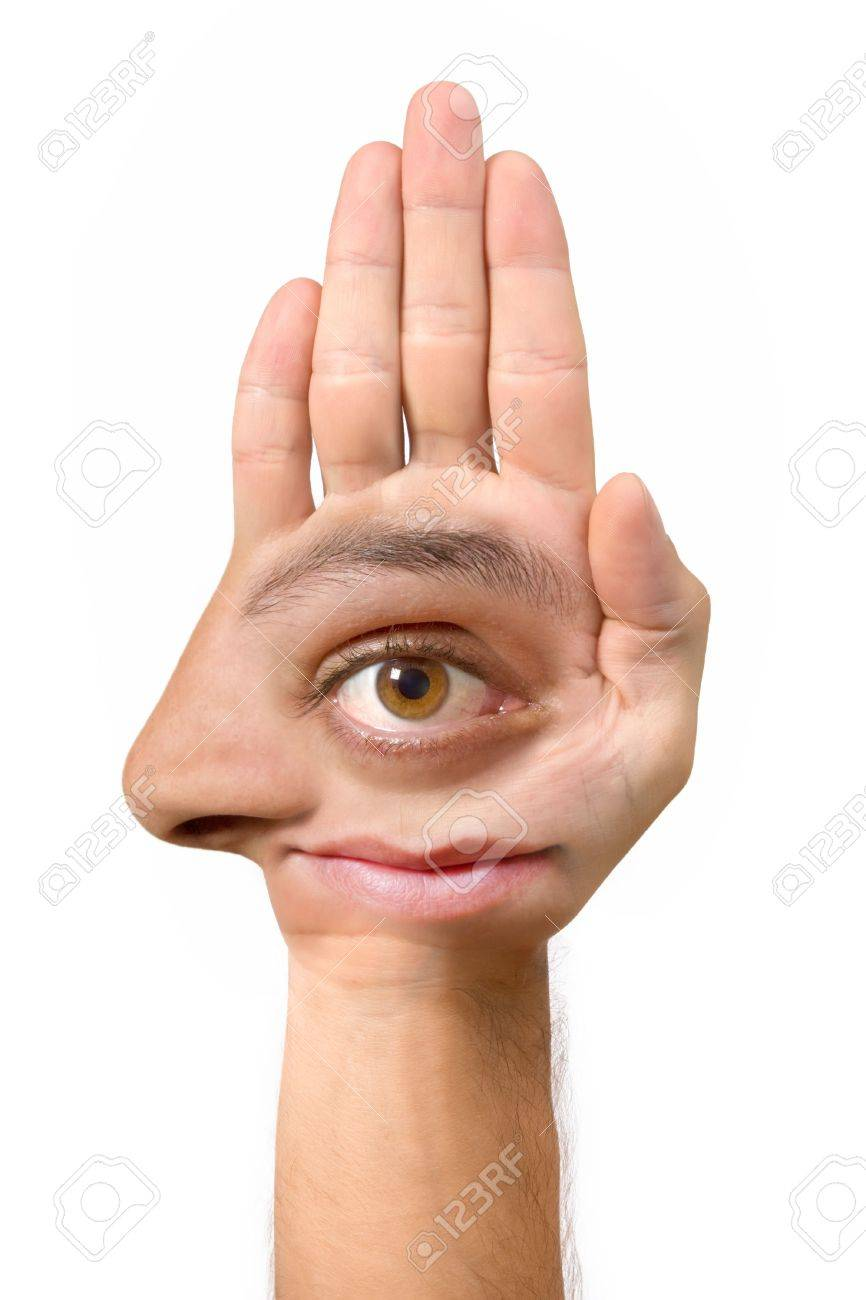 Very ugly face and comical create with the hand with an eye, an ear, the nose, the mouth and a foot Stock Photo - 1868729