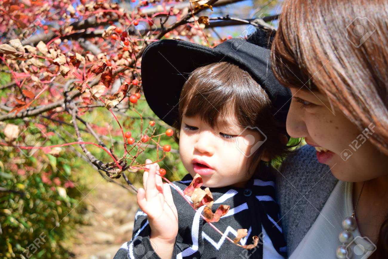 young japanese mother is playing with her son - 80201531