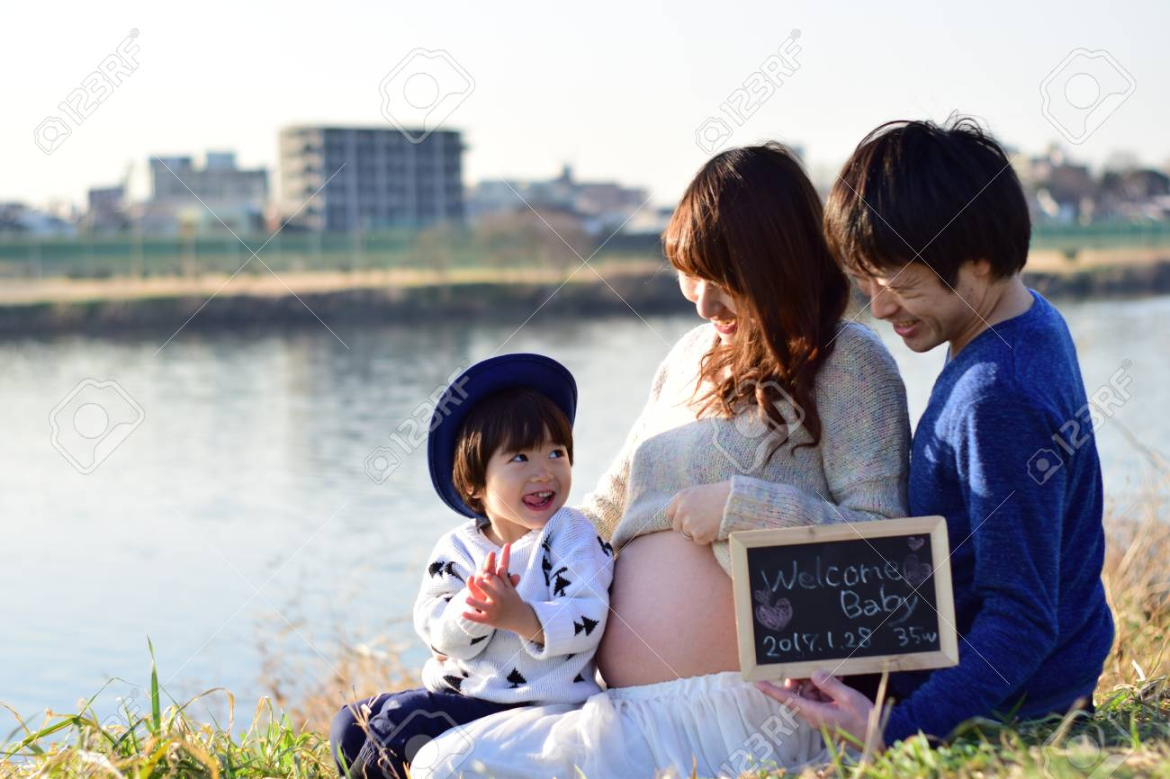 young family taking photo - 89932946