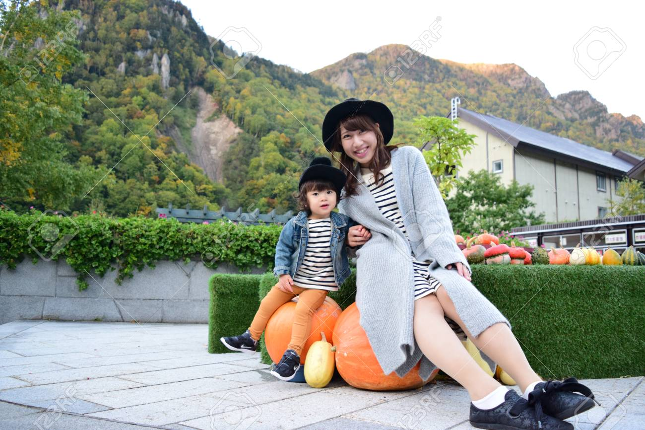 young japanese mother is playing with her son - 89967830