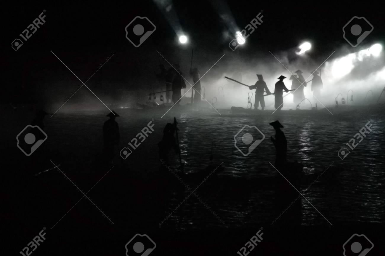 A group of fisherman fishing at night Stock Photo - 899621