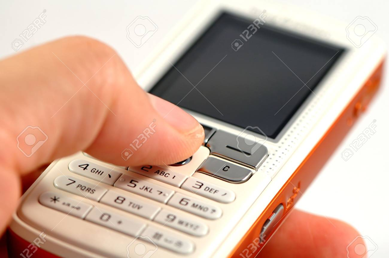 Dialing a modern mobile phone over white Stock Photo - 965137