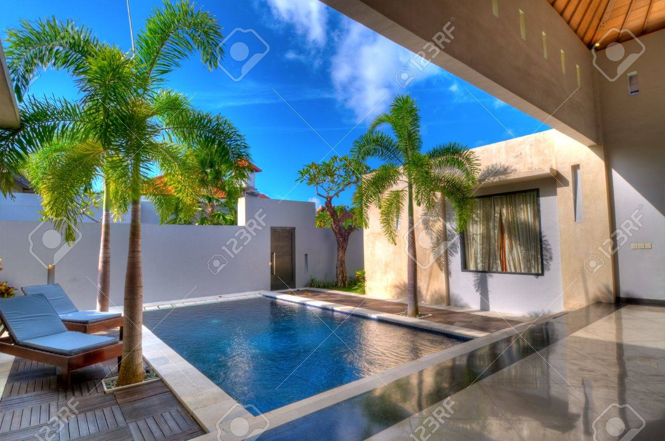 Villa with swimming pool and relaxation bed Stock Photo - 8038533