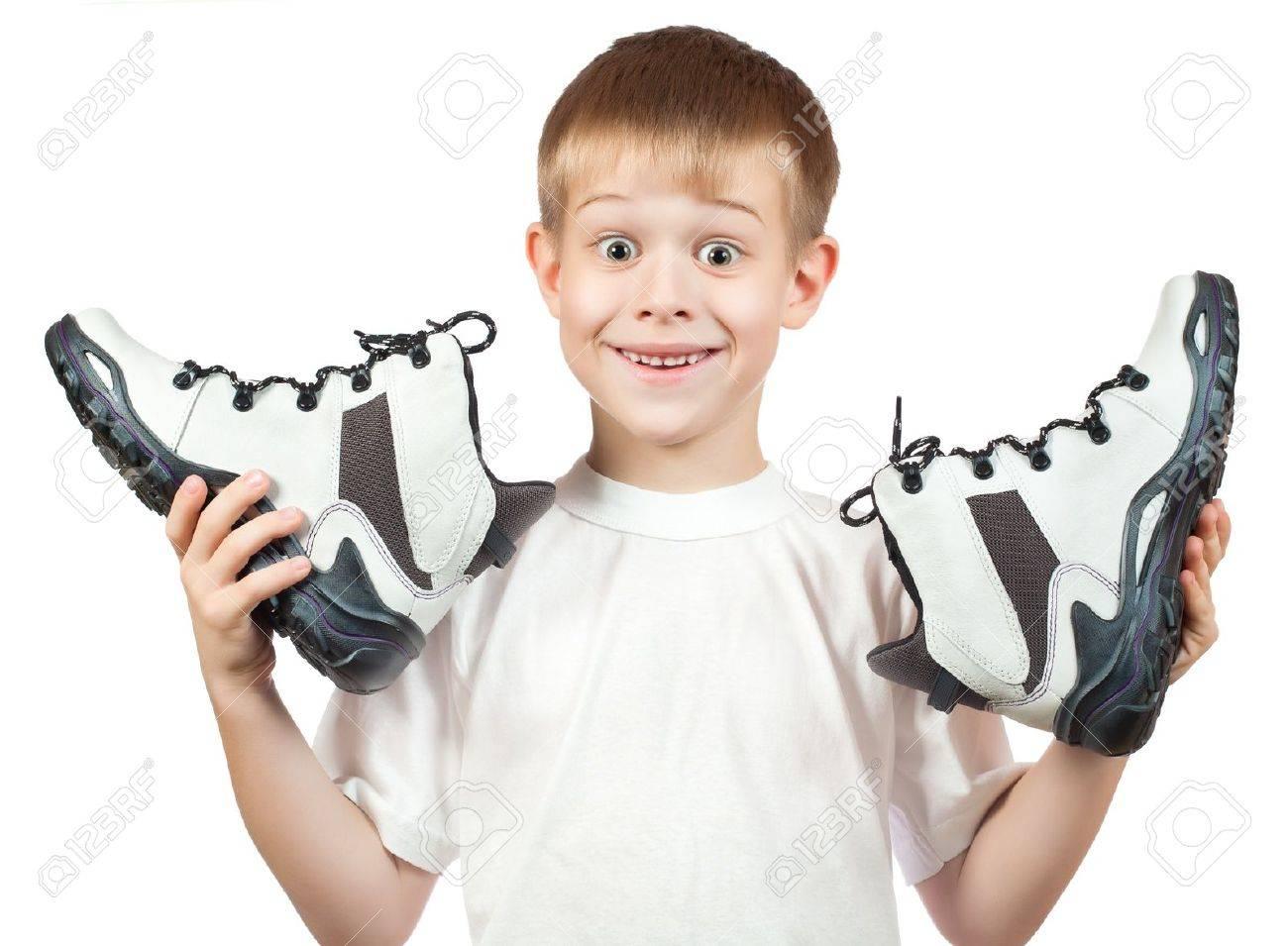 写真素材 , 新しい白い靴と少年のポートレート