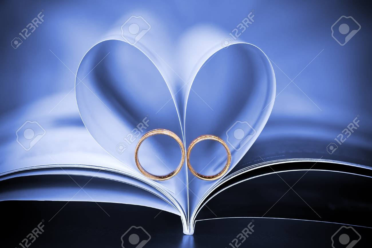 sign of a heart and beautiful golden rings Stock Photo - 16887234