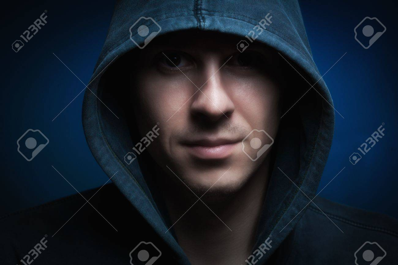 Scary man with hood in darkness Stock Photo - 16908523