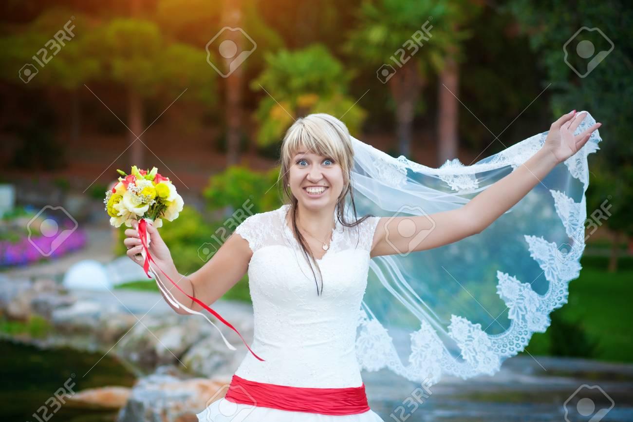 funny bride in white dress in the park Stock Photo - 16977238