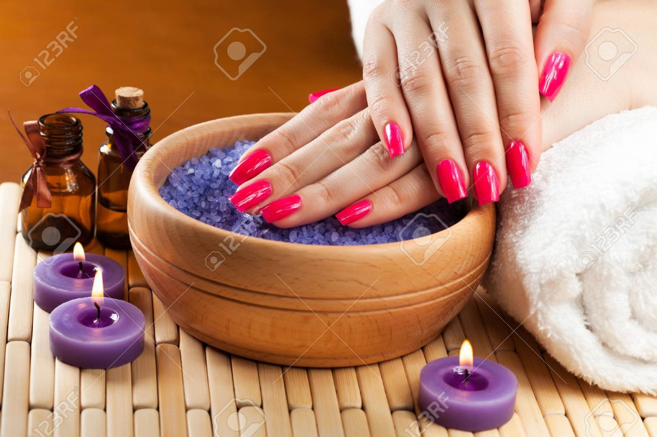 female hands with aromatic candles and towel  Spa Stock Photo - 18098456