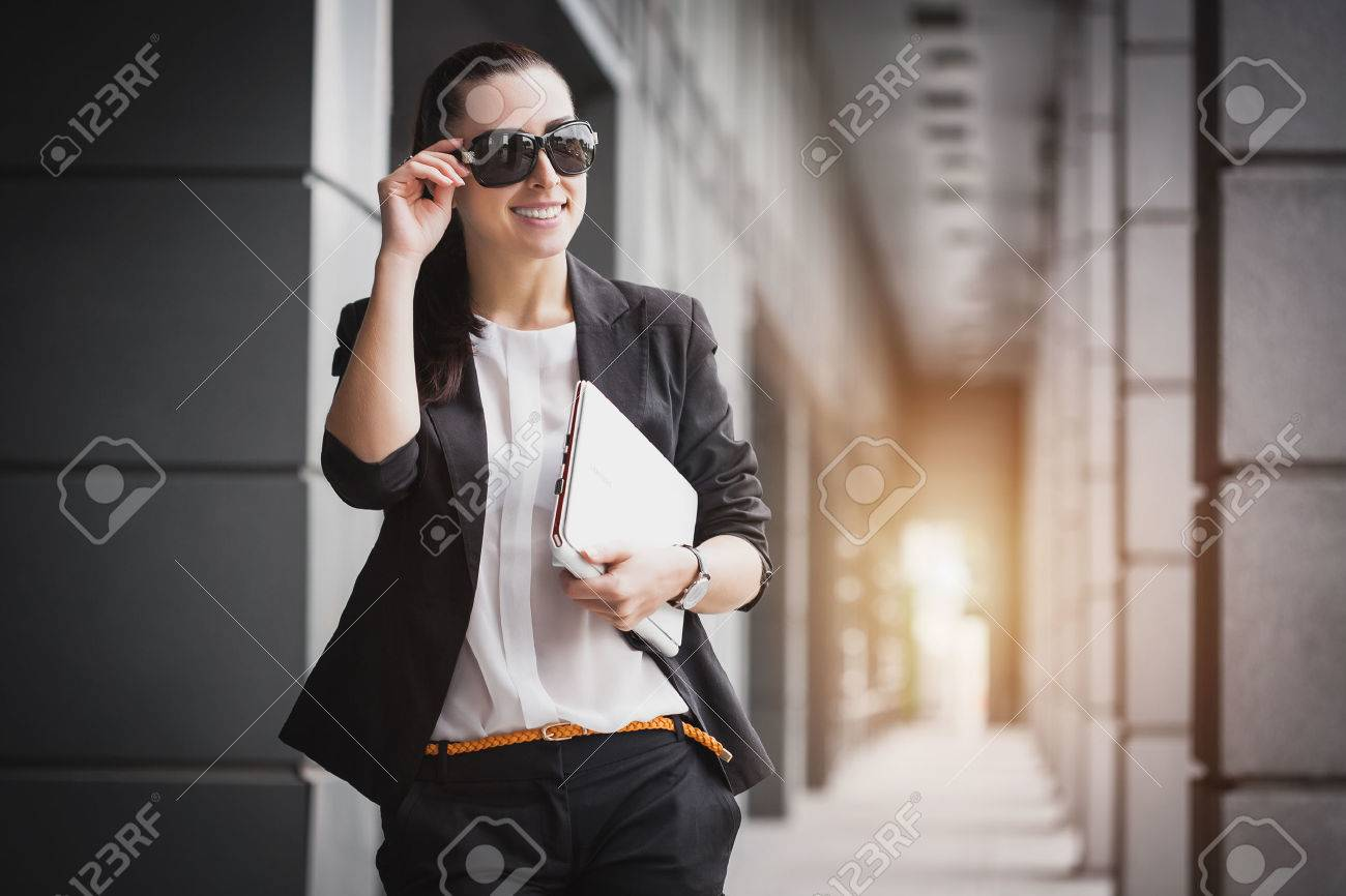 Successful Businesswoman with laptop. City businesswoman working. - 55134551