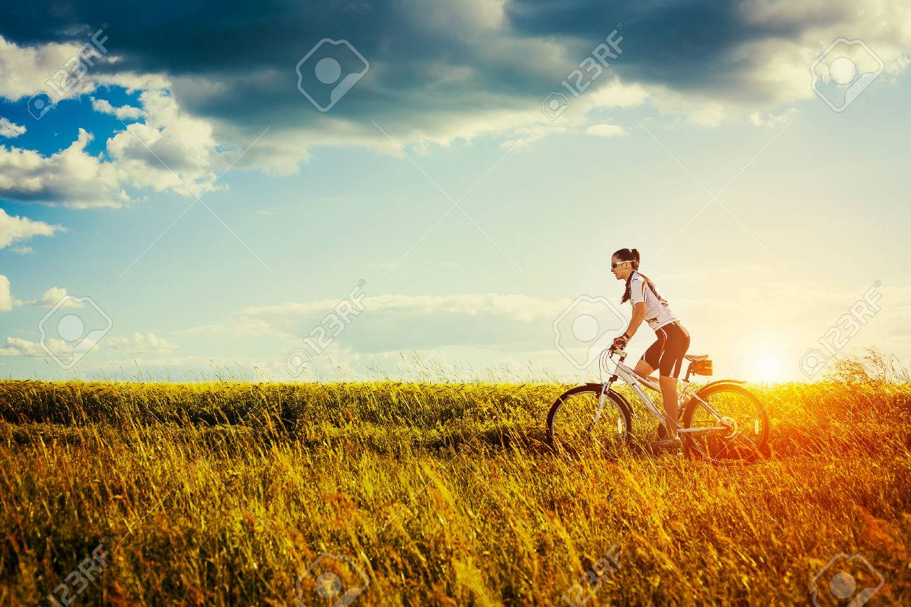 Young Woman is riding bicycle outside  Healthy Lifestyle Stock Photo - 29483358