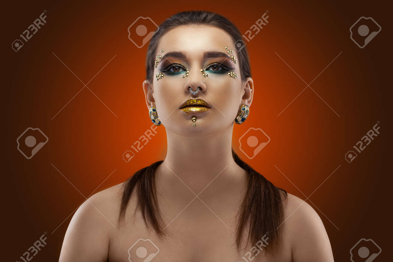 portrait of a girl. luxury shining makeup on the dark background - 122191176