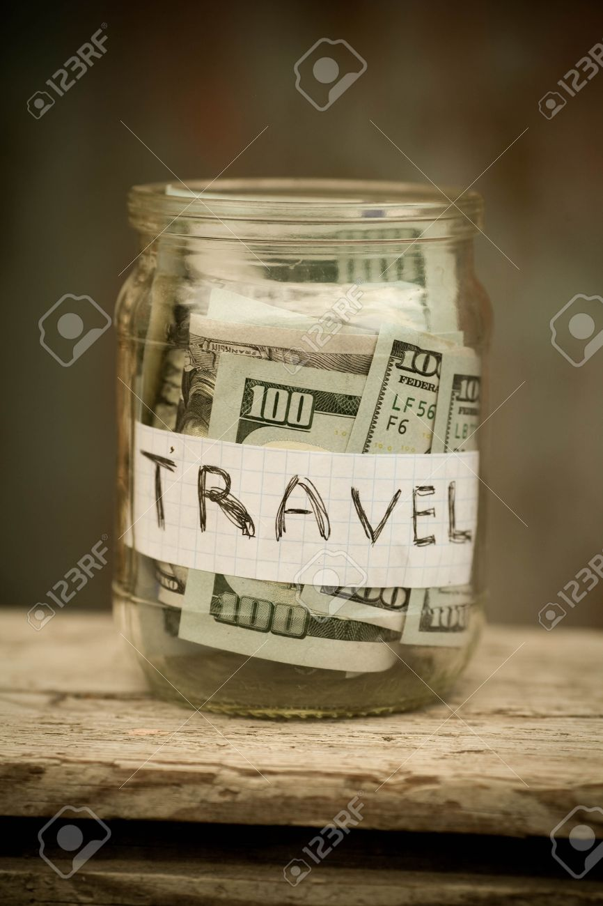 collecting money for travel glass tin as moneybox with cash stock