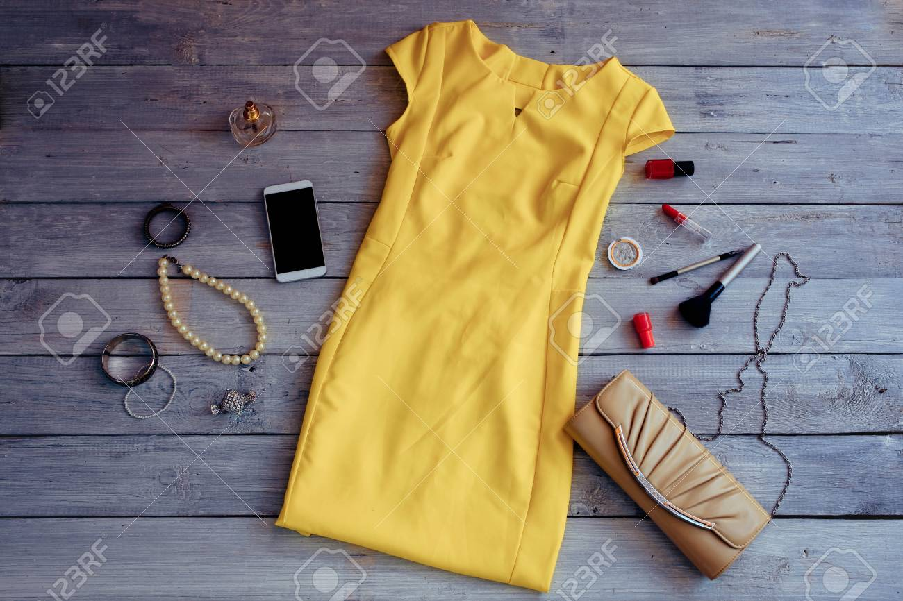 Stock Photo - Women s clothing for summer holidays. Yellow summer clothes  collection. 42c737abbb