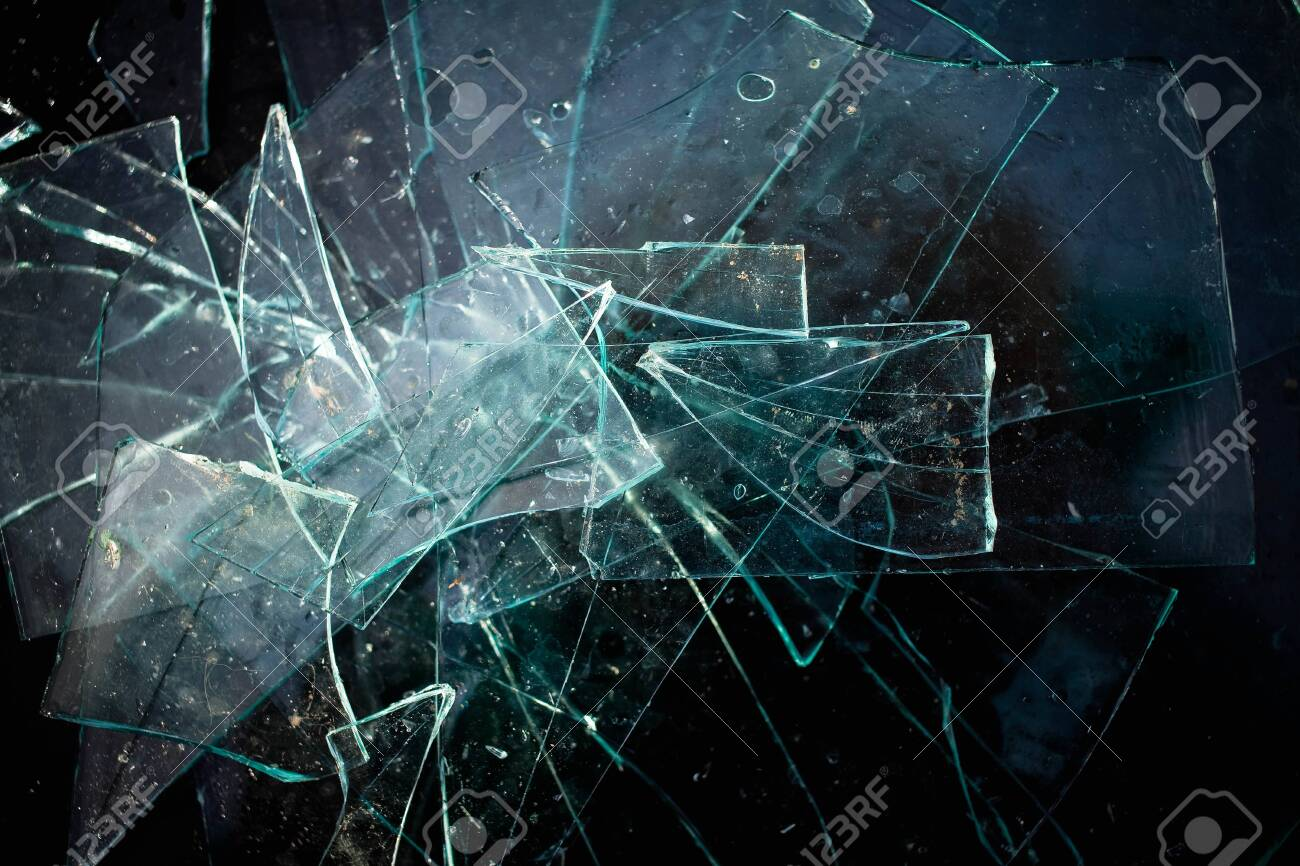Broken glass pile pieces texture and black background. Top view - 143209977