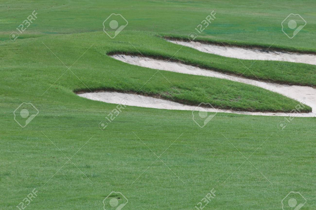 A sand trap on the golf course Stock Photo - 15676453