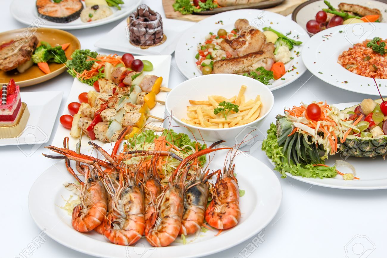 Grilled Shrimp And Many Food On Dining Table Stock Photo Picture