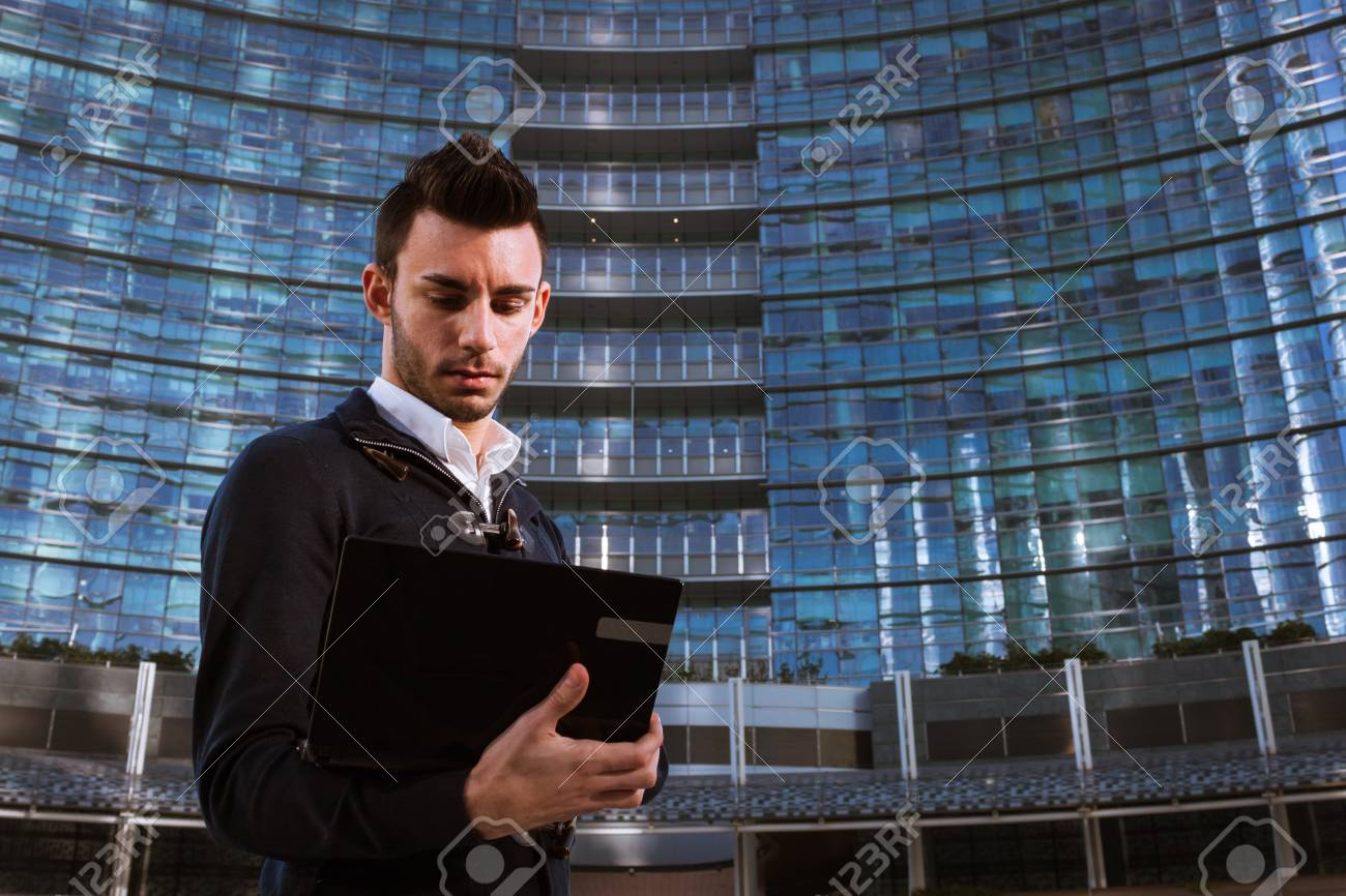 Handsome young man working at computer outdoor Stock Photo - 24605446