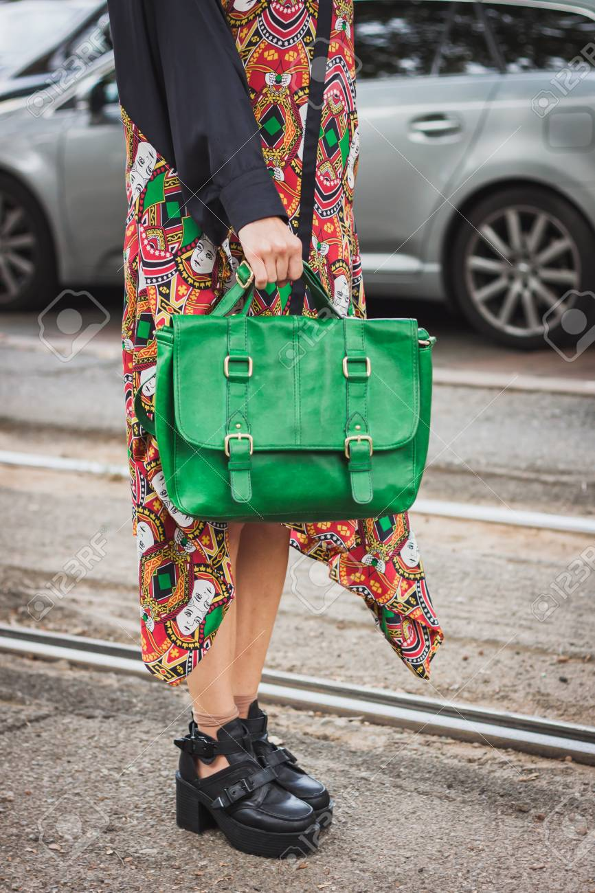 293032aa MILAN, ITALY - SEPTEMBER 17: Detail of bag and shoes outside Gucci fashion  shows