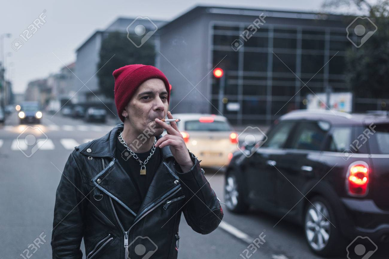 0fc110319ec Punk guy with beanie posing in the city streets stock photo picture jpg  1300x866 Punk guy