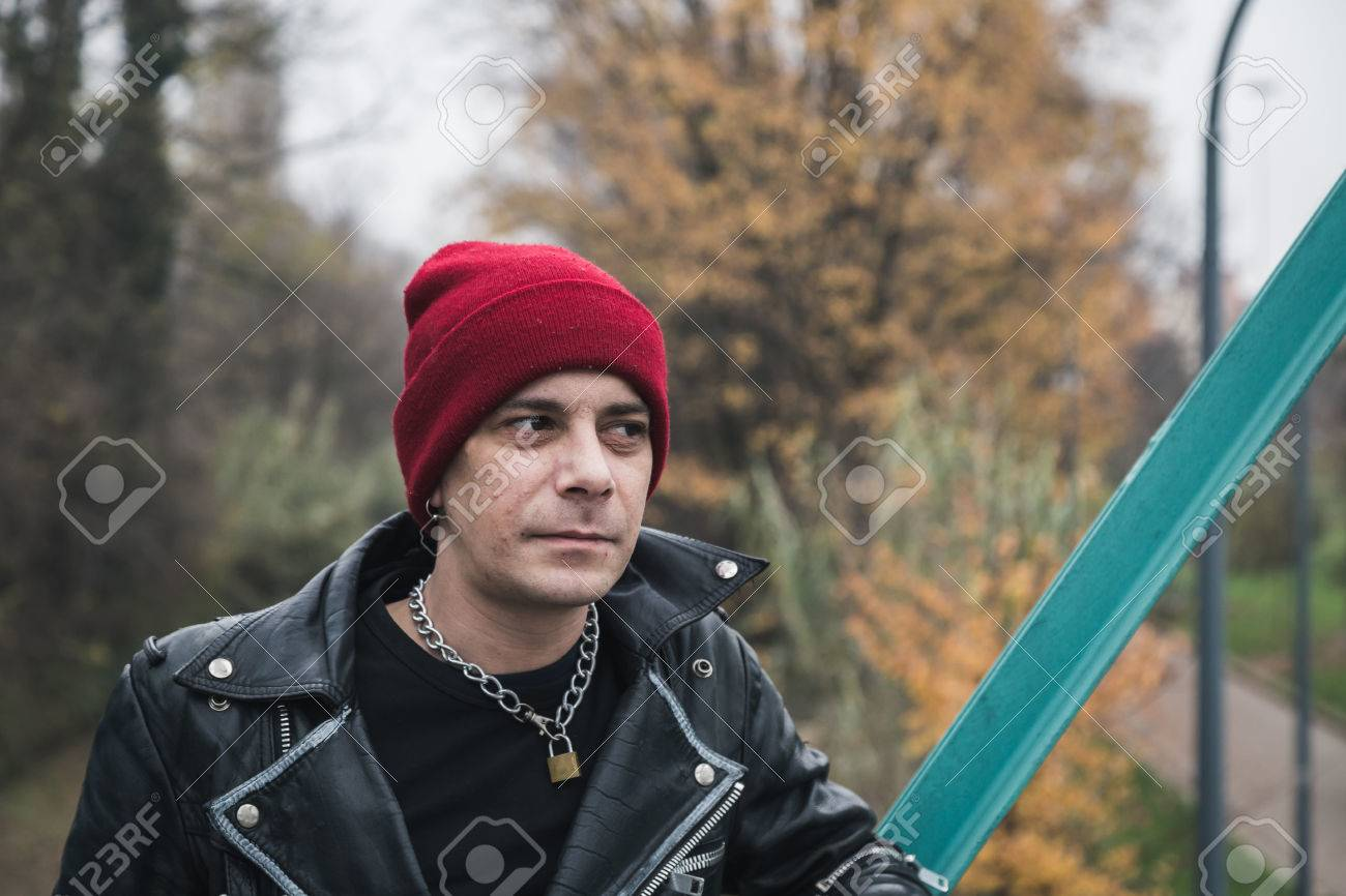 3e184460f3c Punk guy with beanie posing in the city streets Stock Photo - 34600901
