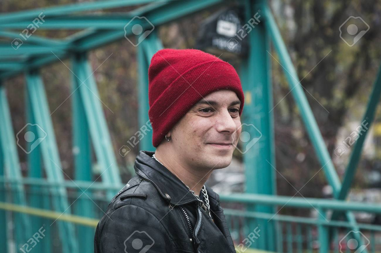 3cd3d9a41ac Punk guy with beanie posing in the city streets Stock Photo - 35361658