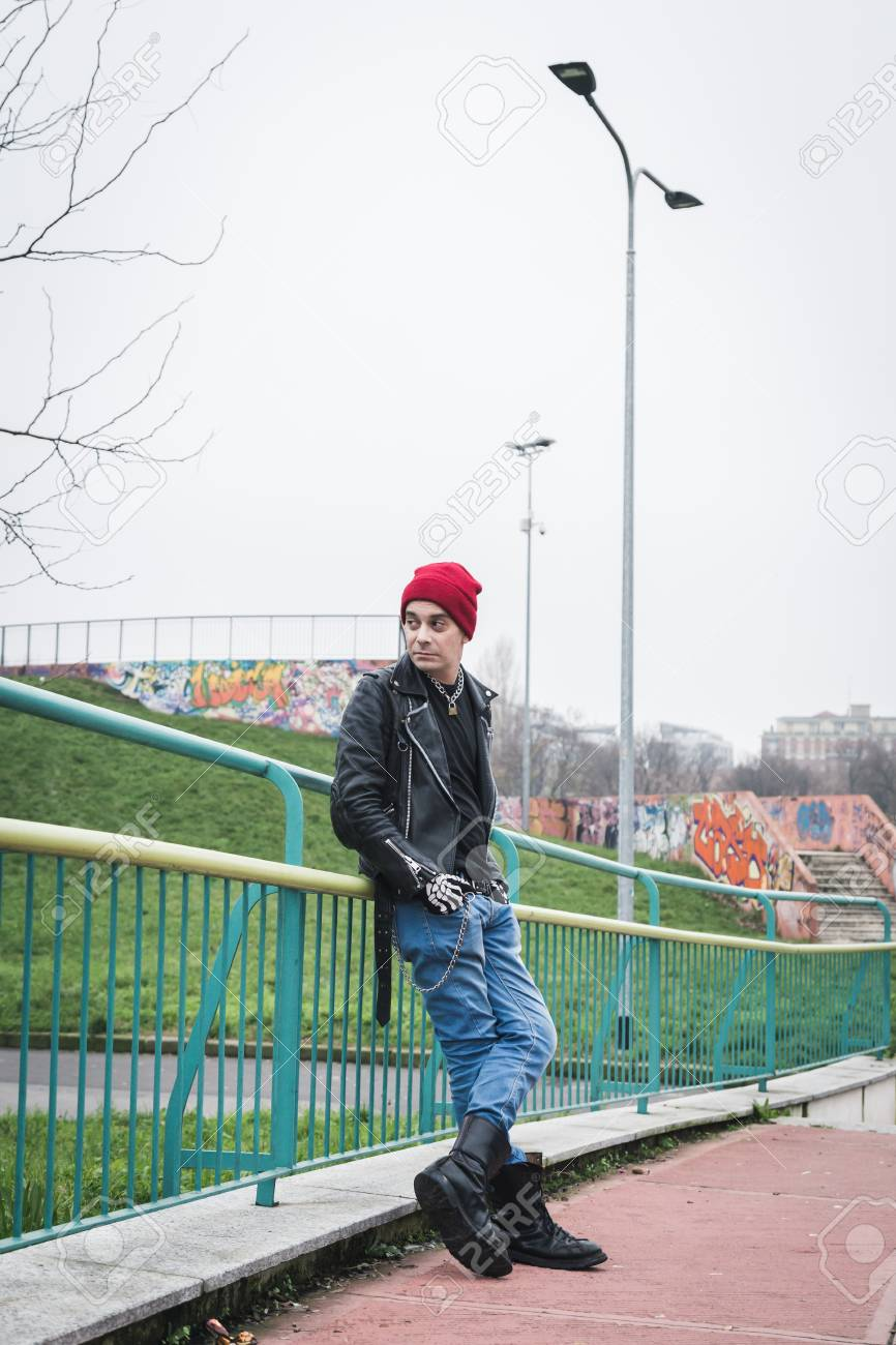 9a3491827e0 Punk guy with beanie posing in a city park Stock Photo - 35361668