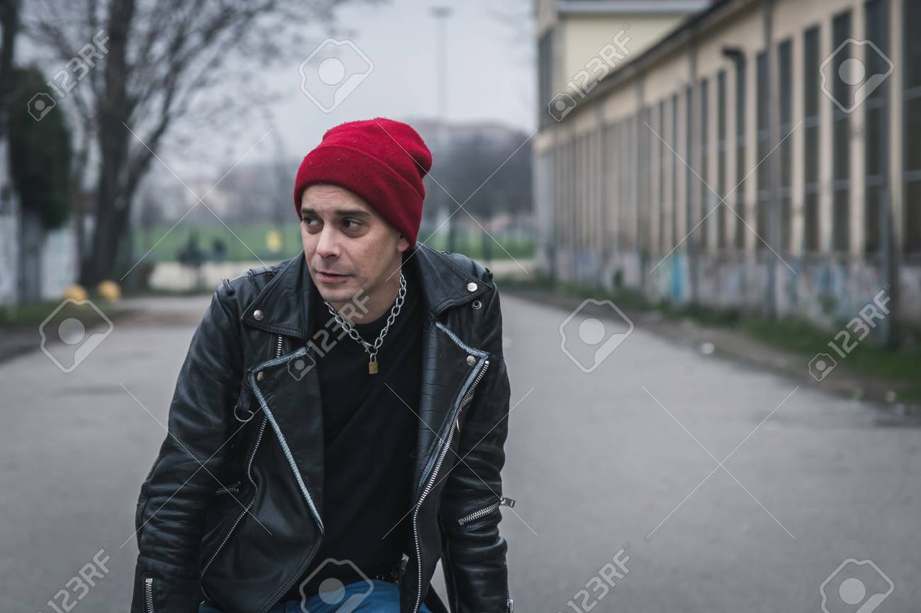 c1bce49c9cd Punk guy with beanie posing in the city streets Stock Photo - 35361780