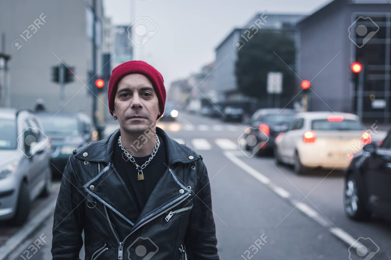 1b69be6b280 Punk guy with beanie posing in the city streets Stock Photo - 35361810