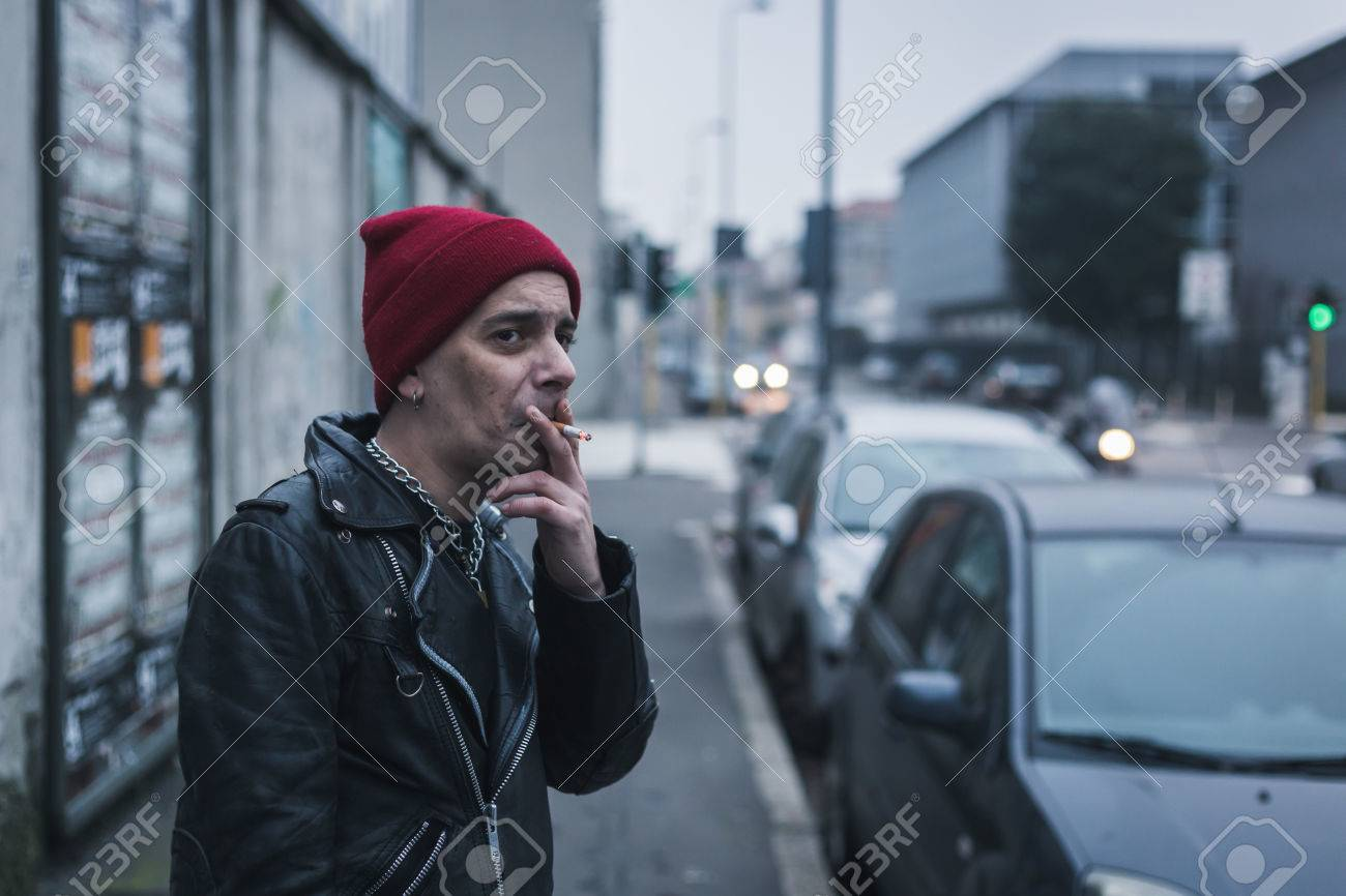 a44f05de3e0 Punk guy with beanie posing in the city streets stock photo picture jpg  1300x866 Rocker guy