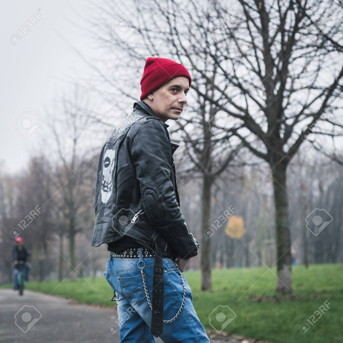 c0abe2e22b7 Punk guy with beanie posing in a city park Stock Photo - 36177668