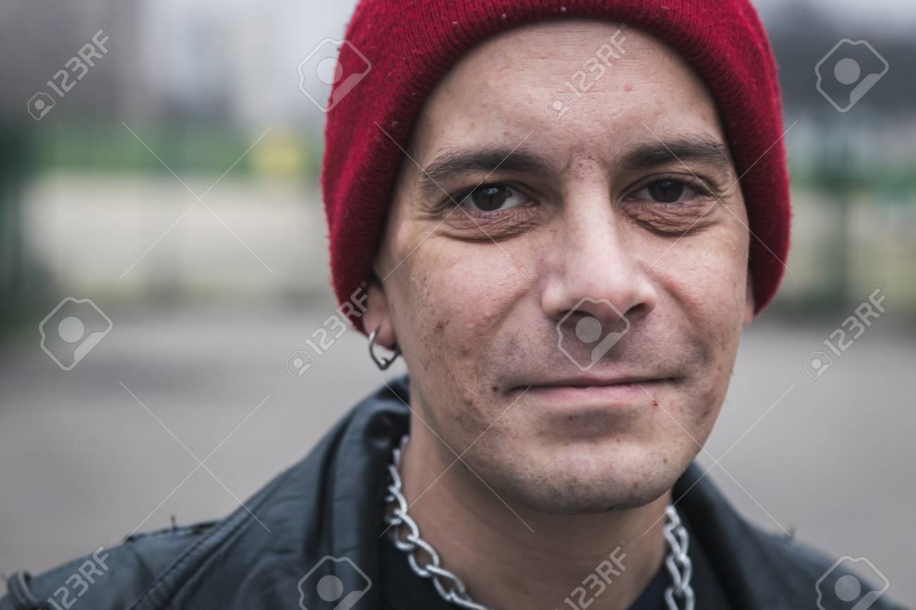 cb8f9fe593d Punk guy with beanie posing in the city streets Stock Photo - 36177672