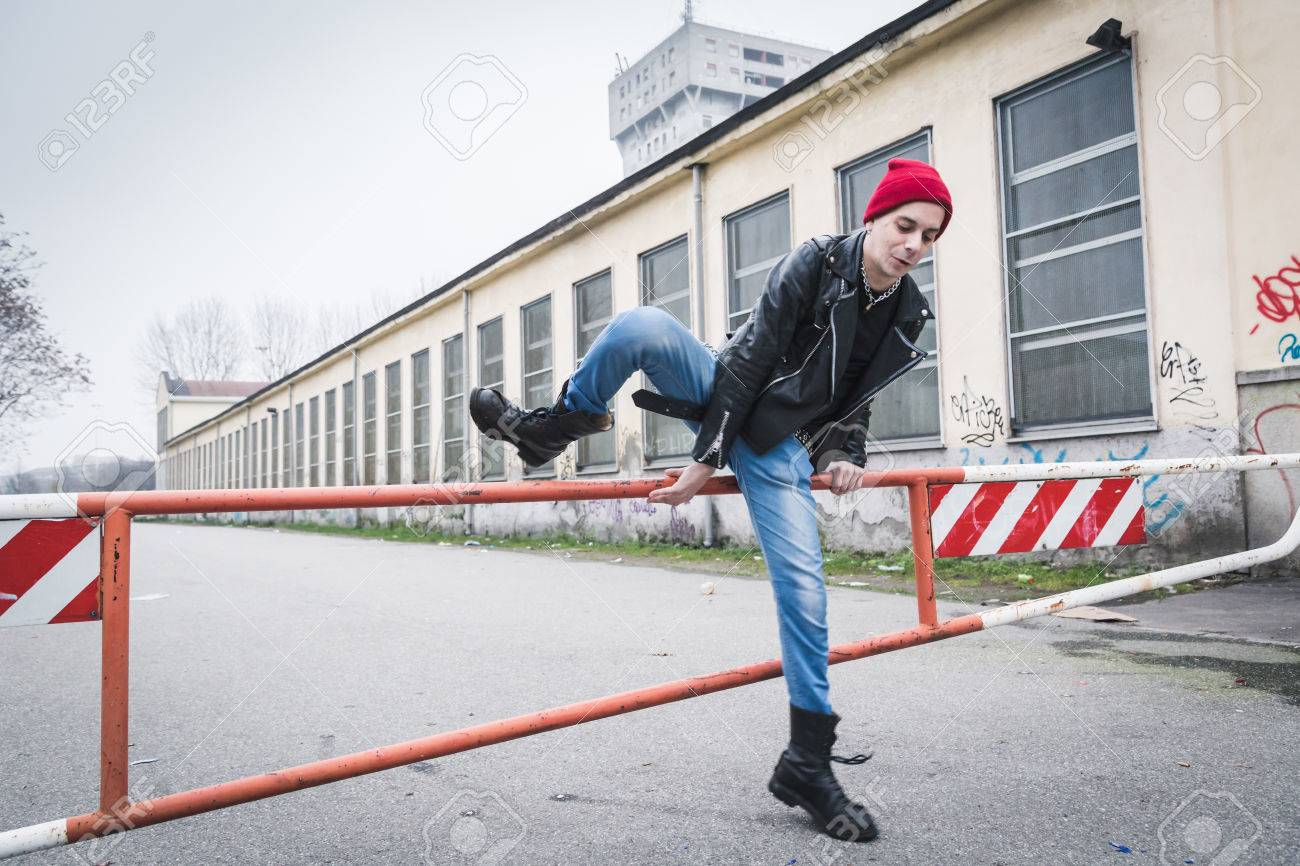 4f5353e77f4 Punk guy with beanie posing in the city streets Stock Photo - 36177674