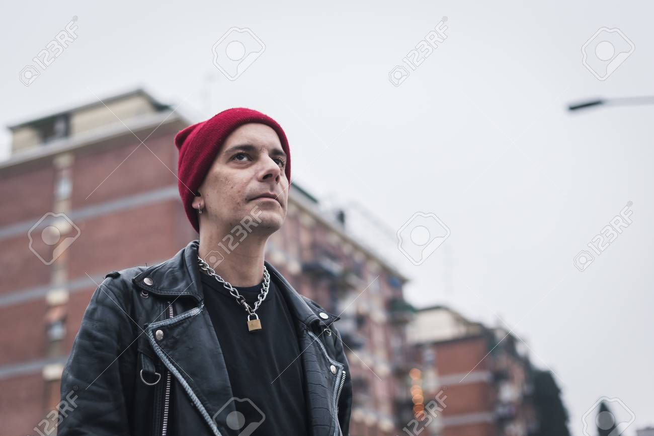0fe2a3ec9b8 Punk guy with beanie posing in the city streets Stock Photo - 36177679