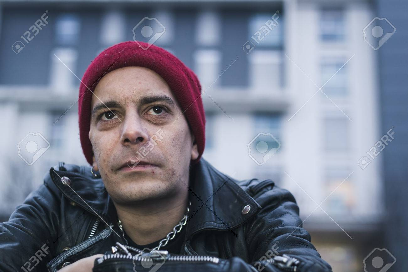 5b153de8295 Punk guy with beanie posing in the city streets Stock Photo - 36177680