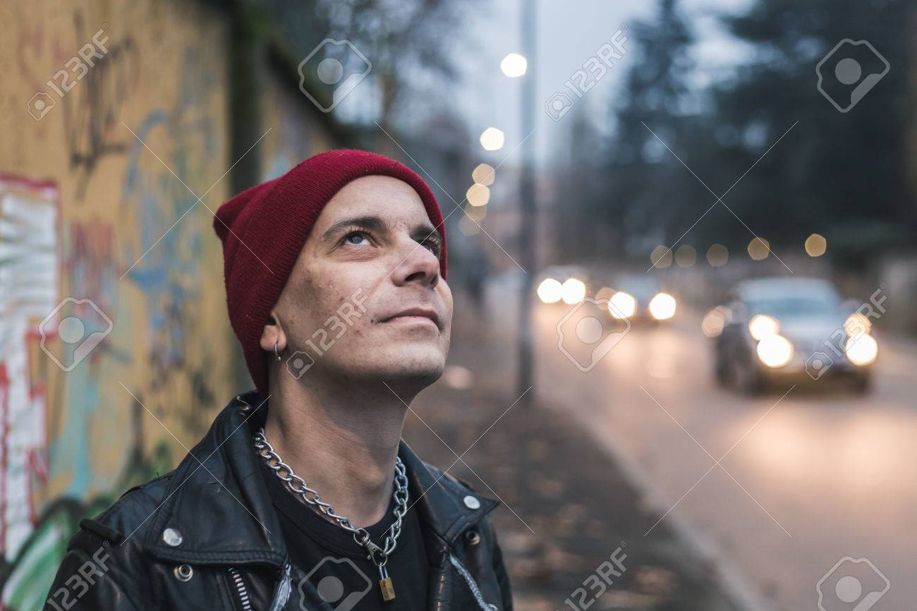 4ef8a9432e4 Punk guy with beanie posing in the city streets Stock Photo - 36177685