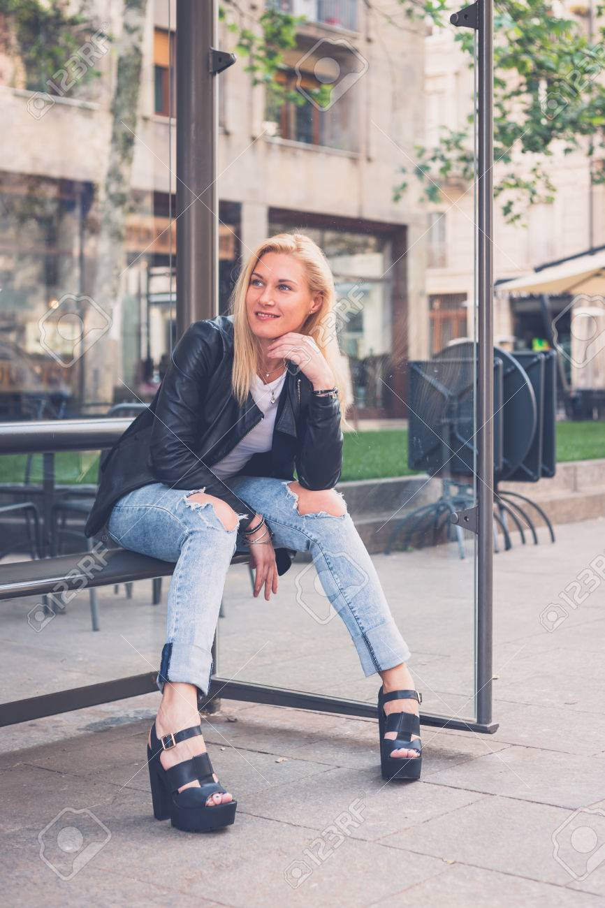 Beautiful Blonde Girl Wearing Ripped Jeans And Leather Jacket