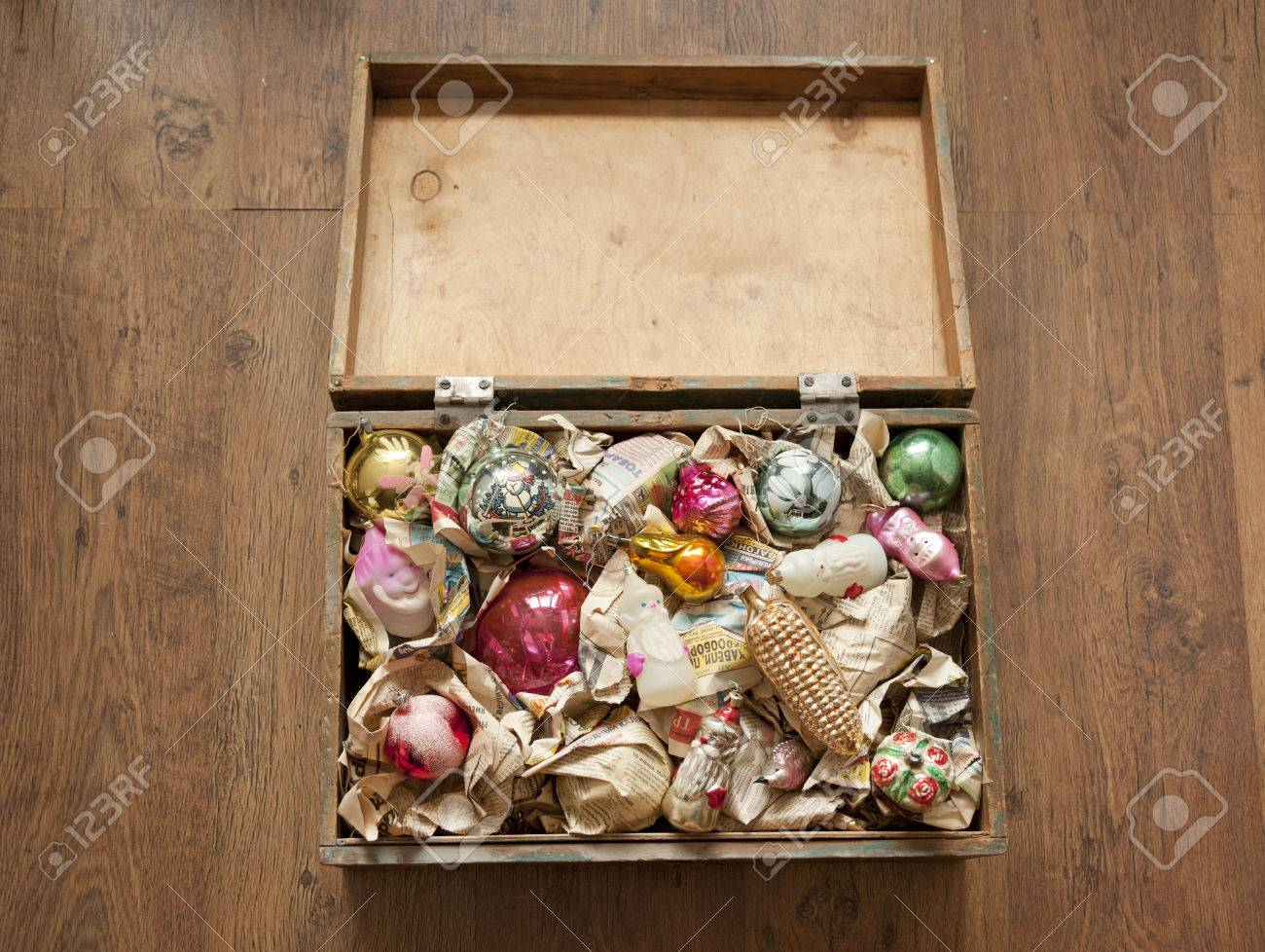 Wooden Box Of Old Christmas Toys Wrapped In Newspaper Stock Photo ...