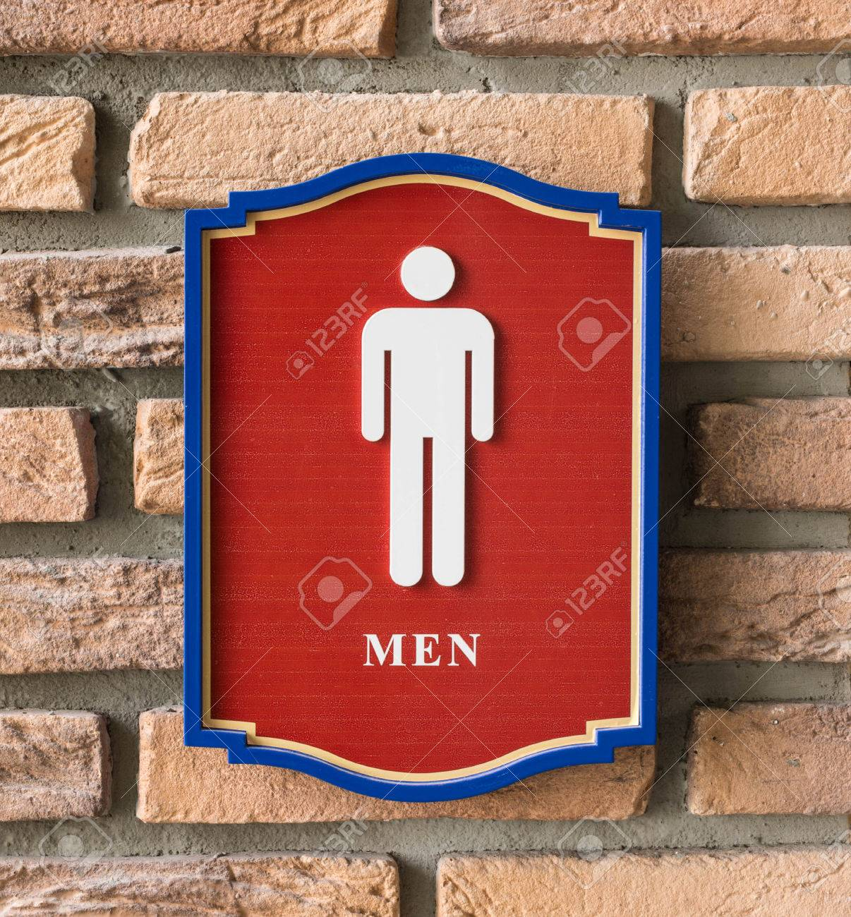 Restroom signs with male symbol on birck wall stock photo 50211681