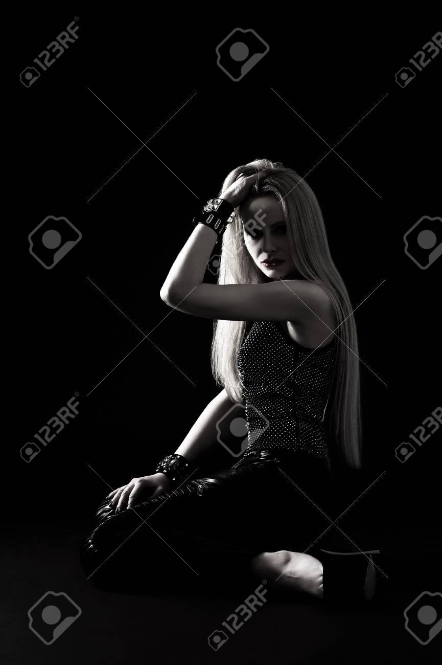 Studio portrait of beautiful young sexual rock woman in stylish jewellery Stock Photo - 18917379