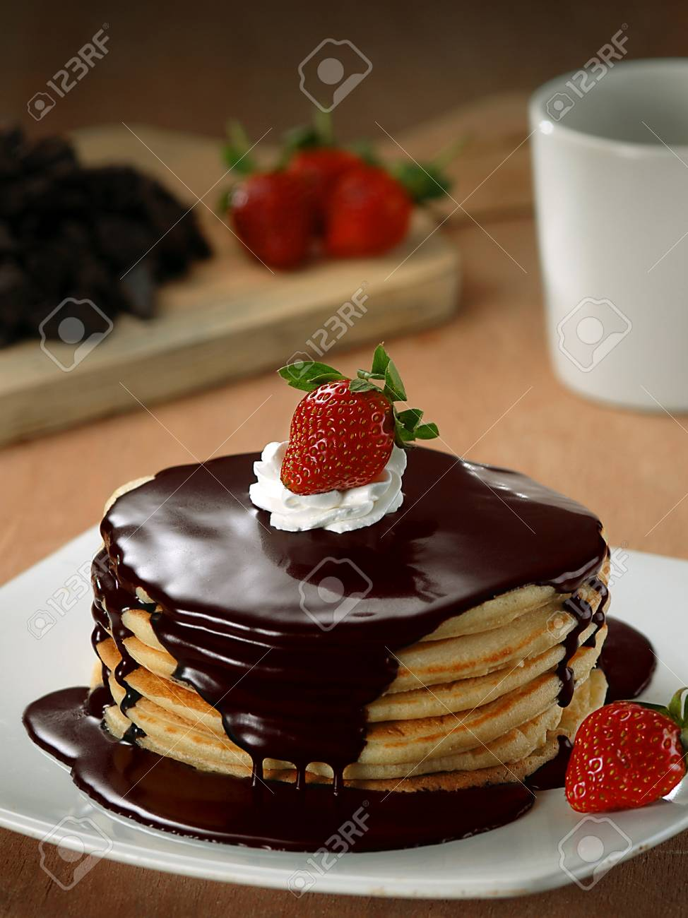 Stack Of Pancakes With Chocolate Syrup Whipped Cream And Strawberries Stock Photo Picture And Royalty Free Image Image 92038709