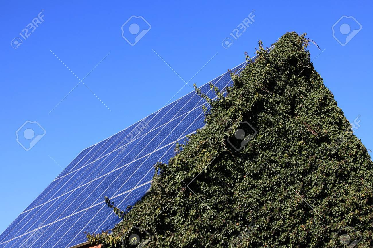 Photovoltaic modules mounted on a barn roof Stock Photo - 11864312