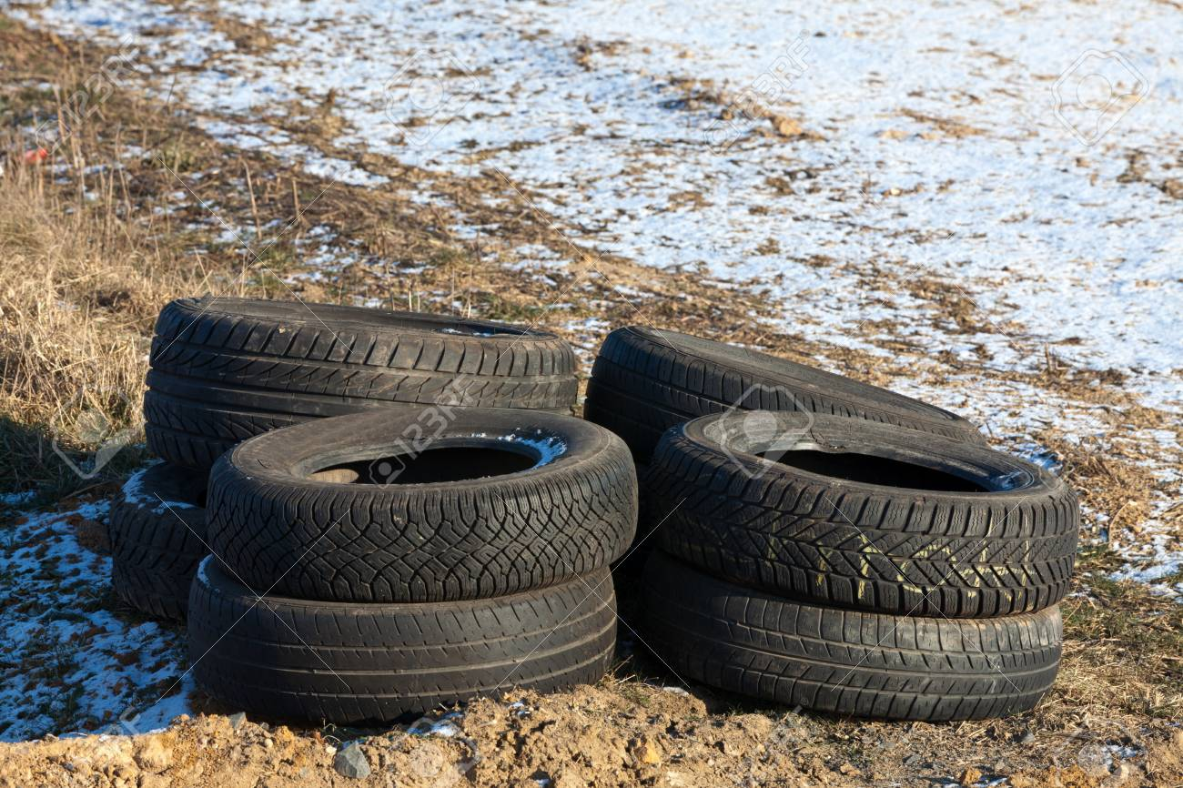 Illegally disposed of tires by the wayside Stock Photo - 12717671