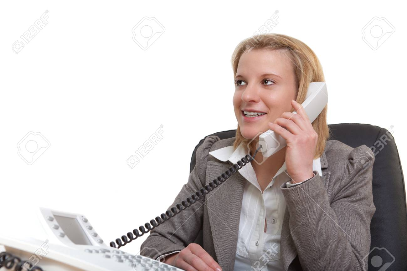 Portrait of a young businesswoman using phone in office Stock Photo - 13374076