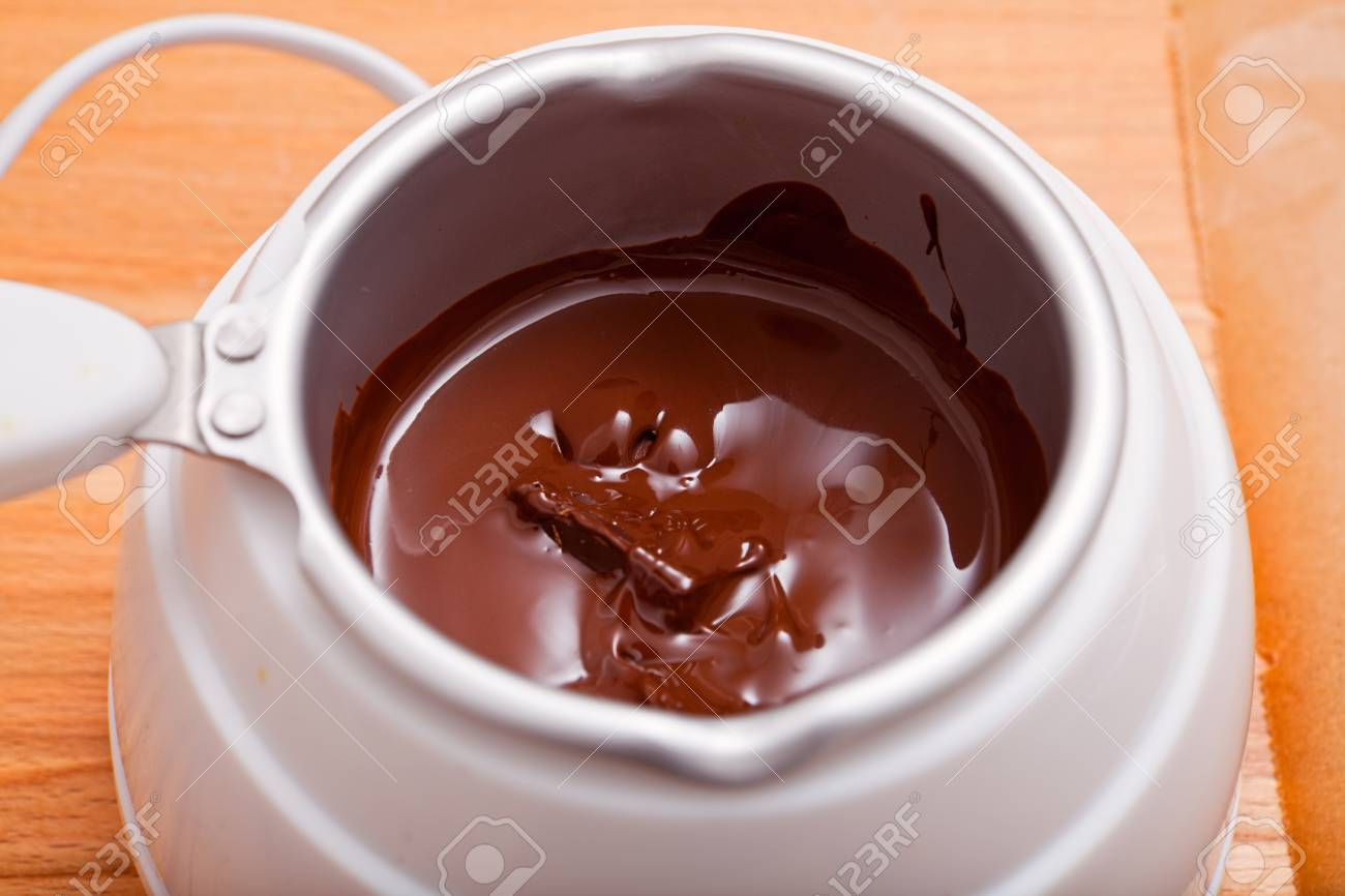 Chocolate Melting Pot Filled With Brown Chocolate
